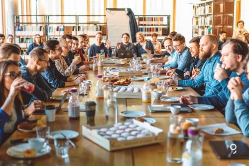 The team of Geogre having breakfast together